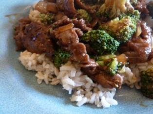 Double check your sauces, but a lot of Asian food is gluten free.  Try this Beef & Broccoli.